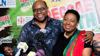 The Minister of Culture, Gender, Entertainment and Sport, the Honourable Olivia Grange (right) shares a light moment with the Minister of Tourism, the Honourable Edmund Bartlett at the launch of Reggae Month 2019, being organised by both ministries.  February is Reggae Month.