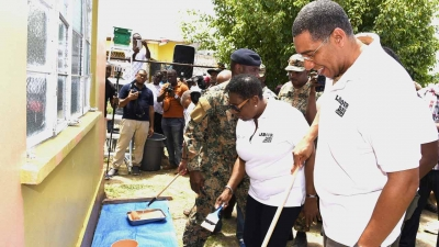 Prime Minister, the Most Honourable Andrew Holness (right) and Minister of Culture, Gender, Entertainment and Sport, the Honourable Olivia Grange, participate in Labour Day activities