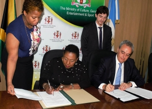 The Honourable Olivia Grange, Minister of Culture, Gender, Entertainment and Sport and His Excellency Ariel Fernandez, Argentinian Ambassador to Jamaica today (December 7) sign an Agreement on Cooperation in the Fields of Art and Culture. The signing was witnessed by Dr Janice, Lindsay, Permanent Secretary (Acting) in the Ministry of Culture, Gender, Entertainment and Sport (left) and Fernando Cané, Chargé d' Affaires (Acting), Embassy of Argentina (right).