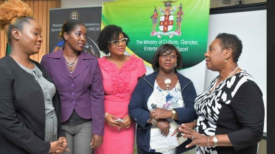 The Minister of Culture, Gender, Entertainment and Sport, the Honourable Olivia Grange (right) in conversation with Dr. Charah Watson; Shernette Mott; Yolande Gooden-Rhoden and Irene Moore (left to right), the first batch of grant recipients in the Women's Entrepreneurship Support Project.