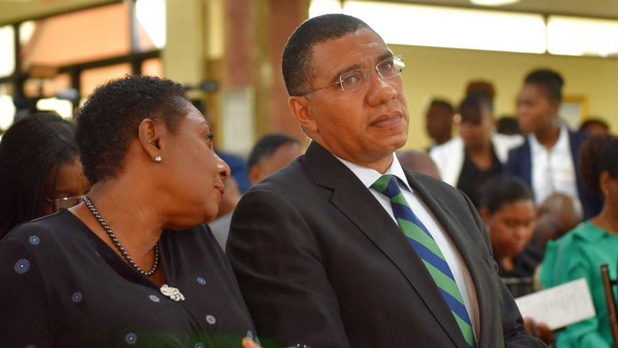Prime Minister, the Most Hon. Andrew Holness (right), listens to  Minister of Culture, Gender, Entertainment and Sport, Hon. Olivia Grange, at a ceremony to launch Workers' Week and Labour Day 2019 activities, at the Office of the Prime Minister on Tuesday (May 7). For both events this year, focus will be placed on the safety of the nation's children.