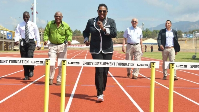 Minister of Culture, Gender, Entertainment and Sport, the Honourable Olivia Grange (centre) leads the 'pack' as they sample the new track at Stadium East. Others in the photograph are: Denzil Thorpe, Permanent Secretary in the Ministry; Major Desmon Brown, General Manager, Independence Park Limited; Mike Fennell, Chairman and David Shirley; Deputy Chairman, Independence Park Limited (left to right).