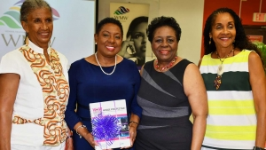 "The Honourable Olivia Grange, Minister of Culture, Gender, Entertainment and Sport (second left) with Judith Wedderburn, Director, WMW Jamaica; Elaine Commissiong, Regional Coordinator and Consultant, Media and Development Programme, WMW Jamaica and Elaine Wint, Transformational Trainer (left to right) at the WMW Jamaica Forum held at CARIMAC Annex 11, University of the West Indies, Mona on Wednesday. Minister Grange was presented with a publication from WMW Jamaica titled, ""Whose Perspective? A Guide to Gender Aware Analysis of Media Content."