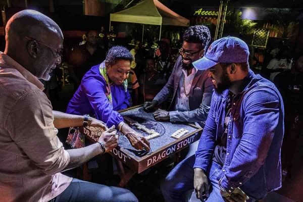 Grange plays domino at the launch of Dragon Stout World Domino Championship