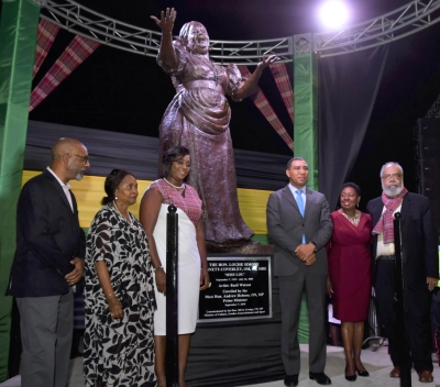Prime Minister, the Most Honourable Andrew Holness and the Honourable Olivia Grange, Minister of Culture, Gender, Entertainment and Sport with Mrs. Juliet Holness, Member of Parliament, East Rural, St Andrew; Judge Pamela Appelt, eo-executor, Louise Bennett-Coverley Estate and Fabian Coverley, son after unveiling the Miss Lou Statue in Gordon Town Square on Friday.
