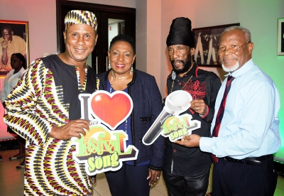 The Honourable Olivia Grange, the Minister of Culture, Gender, Entertainment and Sport with past Jamaica Festival Song Competition winners, Roy Rayon and Tinga Stewart (left to right) and Silvero Castro, Commissioner at the JCDC at the launch of the 2018 Jamaica Festival Song Competition. The event was held at The Twenty-Three Bar on Dominica Drive in New Kingston yesterday (November 30).
