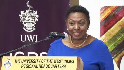 Minister of Culture, Gender, Entertainment and Sport, the Honourable Olivia Grange, addresses the Policy Meeting on Masculinity in the Caribbean at the University of the West Indies Regional Headquarters at Mona.