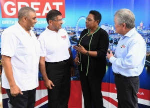 The Honourable Olivia Grange, Minister of Culture, Gender, Entertainment and Sport discusses the upcoming UK/Jamaica Fair with His Excellency Asif Ahmad, British High Commissioner to Jamaica (second left); Leon Mitchell, Group Chief Marketing Officer, Jamaica National Bank and Gary 'Butch' Hendrickson, CEO of the Continental Baking Company (left to right). The fair will take place on March 3 on the lawns of the British High Commission in Kingston.