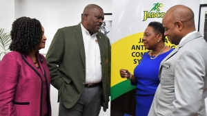 The Minister of Culture, Gender, Entertainment and Sport, the Honourable Olivia Grange (second right) in conversation with Raymond Anderson, Vice President, Jamaica Football Federation and Director, Jamaica Olympic Association (second left); June Spence-Jarrett, Executive Director, Jamaica, Anti-Doping Commission and Alexander Williams, Chairman, JADCO.  Occasion: Symposium organised by JADCO under the theme 'Keeping Sports Clean, Forging Better Partnerships at the Jamaica Conference Centre, Downtown, Kingston.