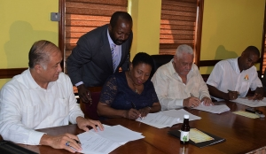The Minister of Culture, Gender, Entertainment and Sport, the Honourable Olivia Grange joined the Minister of Transport and Mining, the Honourable Lester 'Mike' Henry; the Executive Director of the Jamaica Bauxite Institute, Parris Lyew-Ayee and CEO of Timeless Herbal Care, Courtney Betty (l-r) in the signing of a Memorandum of Understanding between the Government of Jamaica