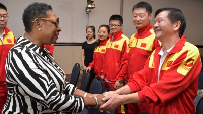 The Honourable Olivia Grange, Minister of Culture, Gender, Entertainment and Sport greets Zou Zhengqiu, gymnastics coach (right) and other members of the Chinese delegation at a function earlier today at the Jamaica Pegasus Hotel. Seven coaches, representing seven disciplines: Synchronised Swimming, Gymnastics, Swimming, Badminton, Women's Volleyball, Women's Football and Women's Basketball, a team manager and an interpreter are now in Jamaica to commence year two of the Jamaica/China Technical Cooperation Project on Sport Coaching.