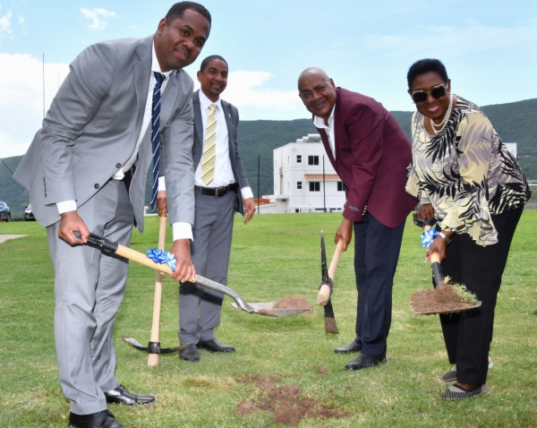 The Honourable Olivia Grange, Minister of Culture, Gender, Entertainment and Sport (right); President, Jamaica Football Federation, Michael Ricketts (second right); Development Manager, FIFA Regional Office in the Caribbean, Marlon Glean (left) and Mayor of Kingston, Senator Councillor Delroy Williams broke ground for the installation of an artificial turf at the football field at the UWI-JFF Captain Horace Burrell Centre of Excellence at the University of the West Indies on Tuesday.