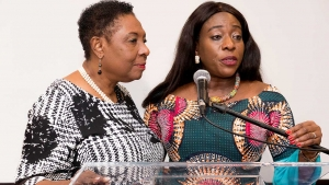 The Minister of Culture, Gender, Entertainment and Sport, the Honourable Olivia Grange (left) listens as the Minister of Minister of Tourism, Arts and Culture of Ghana, Her Excellency Catherine Afeku invites Jamaicans to make a pilgrimage to the African continent, starting with Ghana, at least once in their lifetime.  Minister Grange announced that Jamaica was giving support to Ghana's Year of Return initiative.