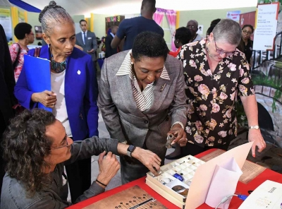 The Honourable Olivia Grange, Minister of Culture, Gender, Entertainment and Sport, examines artefacts dating back to 1750 which were discovered on the University of the West Indies, Mona Campus. The artefacts were displayed as part of the UWI Research Days exhibition on Wednesday, 7 February 2018. Photographed are: Zachary Beirer, Assistant Lecturer, History and Archaelogy, UWI; Dr Camille Bell-Hutchinson, Campus Registrar and Professor Denise Eldemire-Shearer, Chair, Research Days 2018 Committee (left to right).
