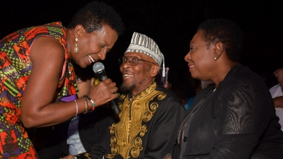 Karen Smith serenades Jimmy Cliff during the Civic Ceremony held in his honour to mark the renaming of Gloucester Avenue in Montego Bay to Jimmy Cliff Boulevard, on Thursday, March 28, 2019 at the Old Hospital Site in Montego Bay, St James. Also enjoying the moment is Minister of Culture, Gender, Entertainment and Sport, the Honourable Olivia Grange.