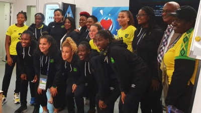 Minister of Culture, Gender, Entertainment and Sport, the Honourable Olivia Grange with JFF President, Michael Ricketts; women's football campaigner, Elaine Walker Brown and members of the Reggae Girlz in Paris, France
