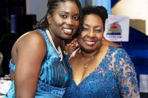 Minister of Culture, Gender, Entertainment and Sport, the Honourable Olivia Grange, shares a moment with adolescent mother Yasheka Brooks.  The Minister has offered to clear the balance on Miss Brooks' tuition fees.