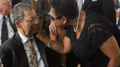 Minister of Culture, Gender, Entertainment and Sport, the Honourable Olivia Grange (right) greets the former Deputy Prime Minister, the Honourable Dr Kenneth Baugh
