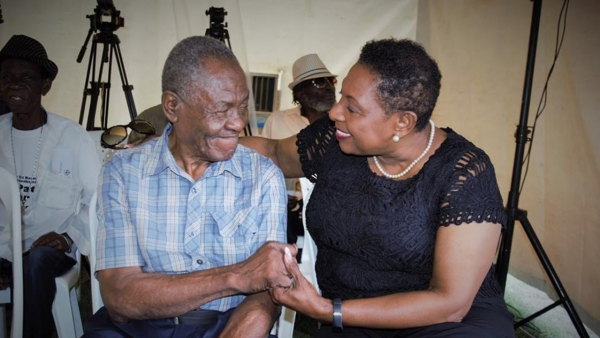 "Sport Minister, Honourable Olivia Grange, shares a moment with boxing legend George Leslie ""Bunny"" Grant"