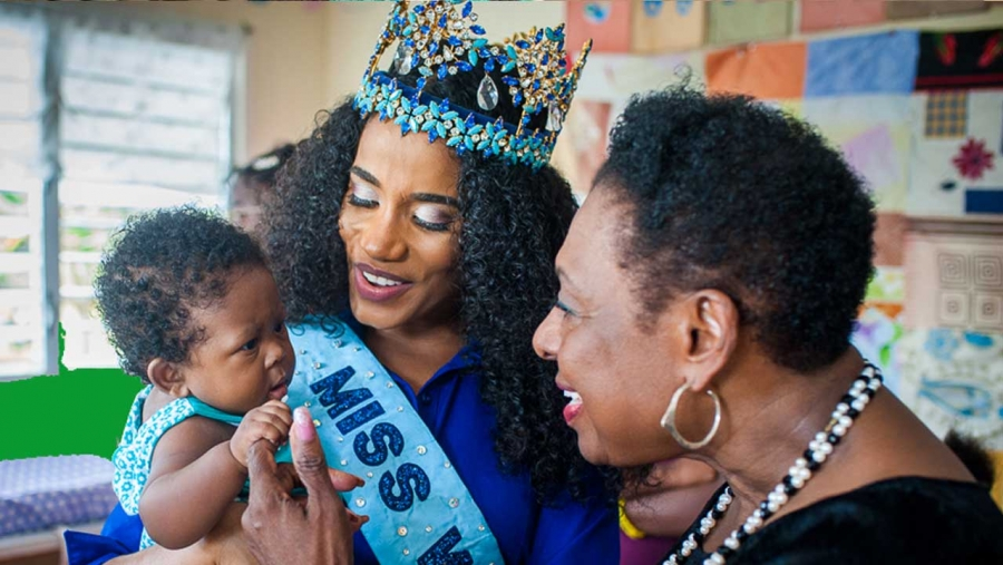 Miss World 2019, Toni-Ann Singh, with a new born at the Women's Centre of Jamaica Foundation location in Morant Bay, St Thomas.  The Minister of Culture, Gender, Entertainment and Sport, the Honourable Olivia Grange shares the moment.