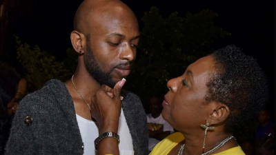 Minister of Culture, Gender, Entertainment and Sport, the Honourable Olivia Grange comforts Jamaican footballer, Luton Shelton