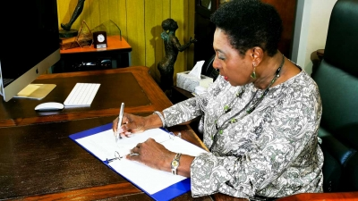 The Minister of Culture, Gender, Entertainment and Sport, the Honourable Olivia Grange, signs the Call to Action on Women's Economic Empowerment. The International initiative is being led by the US Government.