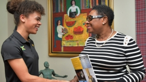 The Honourable Olivia Grange, Minister of Culture, Gender Entertainment and Sport (right) greets Lydia Heywood, the English-born Eventing rider who plans to represent Jamaica at the next Olympics