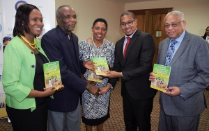 The Honourable Olivia Grange, Minister Culture, Gender, Entertainment and Sport (centre); the Honourable Floyd Green, State Minister in the Ministry of Education Youth and Information (second right), Professor Archibald McDonald, Pro Vice Chancellor and Principal of the University of the West Indies Mona (right) and Keleen Young-Grandison, Project Manager, Sugar Transformation Unit, Ministry of Industry, Commerce, Agriculture and Fisheries (left) receive copies of the book 'Journey of the Jamaica Sugar Cane Industry 1494-2012' from author David Crossbourne (second left). The presentation was made at the press launch of the UWI-GOJ Series, Sugar Cane: Recycling Sweetness and Power in Modern Jamaica' for adults and Ms Sugga, for children.