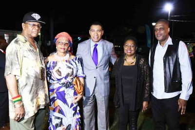 Prime Minister, the Most Hon Andrew Holness, (centre) and Minister of Culture, Hon Olivia Grange (fourth from left) share lens with from left, Copeland Forbes, tour manager, Reggae Superstar Marcia Griffiths, and radio personality Ken Williams (far right). Occasion was the Prime Minister's reception to celebrate Reggae Month on Tuesday, February 20, on the lawns of Jamaica House.