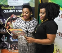The Honourable Olivia Grange, Minister of Culture, Gender, Entertainment and Sport, presents Recording Artiste Etana (second right), with a cheque valued at USD 5000 on Thursday (February 8). The funds were provided, to support Etana's 32-city United States tour, through the Ministry's Artiste Ambassador and Tour Support Programme. Also photographed are: Nathan Cowan, CEO, Talent Entertainment Booking Agency (right); Denzil Thorpe, Permanent Secretary (third right) and Gillian Wilkinson-McDaniel, Senior Director, Entertainment in the Ministry (second left).