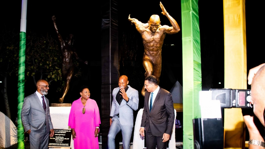 The Prime Minister, the Most Honourable Andrew Holness (right) and the Minister of Culture, Gender, Entertainment and Sport, the Honourable Olivia Grange (2nd left) share a light moment with Jamaican sprinter, Asafa Powell (2nd right) after the unveiling of a statue in the athlete's honour in Statue Park at the National Stadium.  Sharing the moment is the sculptor, Basil Watson.