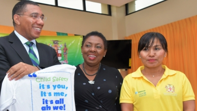 "Prime Minister, the Most Honourable Andrew Holness holds up a t-shirt to be worn by volunteers at Labour Day 2019 projects.  Labour Day 2019 on May 23 will be observed under the theme ""Child Safety…it's you, it's me, it's all ah we."" Sharing the moment are Minister of Culture, Gender, Entertainment and Sport, the Honourable Olivia Grange (who chairs the National Labour Day Committee) and Ms. Mariko Kagoshima, Country Representative for Unicef Jamaica.  Unicef is working with the National Labour Day Committee in the execution of projects this year."