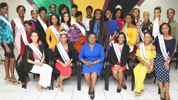 The Honourable Olivia Grange, Minister of Culture, Gender, Entertainment and Sport (seated third left) has told finallists in the Miss Universe Jamaica 2018 Pageant that the Ministry is willing to work with them especially since they all have interests and skills related to her portfolio. Miss Grange received the contestants when they paid a Courtesy Call on her at the Ministry on Wednesday during which they were also introduced to the Honourable Alando Terrelonge, Minister of State in the Ministry.