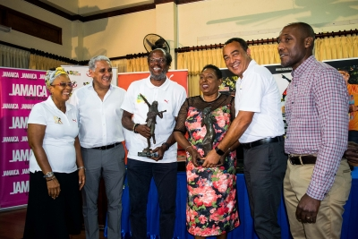 The Honourable Olivia Grange, Minister of Culture, Gender, Entertainment and Sport and Dr. the Honourable Christopher Tufton, Minister of Health, share a light moment with Reggae Marathon Sponsorship Director, Diane Ellis; Chairman, Richard Lake; Race Director, Alfred 'Frano' Francis and Jamdammers Running Club of Kingston President, Dr Leon Vaughn (l-r) at the Media Launch for Reggae Marathon Half Marathon & 10K earlier today at the Alhambra Inn in Kingston.