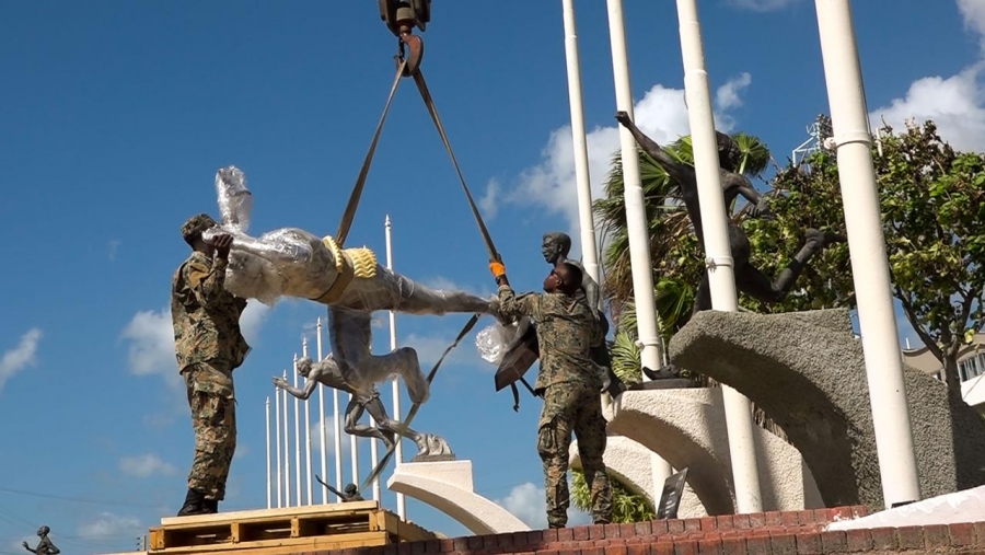 Soldiers from the Jamaica Defence Force mounting the statue of Asafa Powell at Statue Park, National Stadium.  Prime Minister, the Most Honourable Andrew Holness, will unveil the statue in special ceremony on Sunday, 9 February 2020.