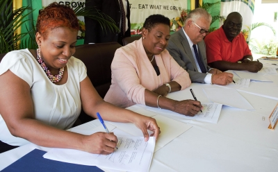 The Minister of Culture, Gender, Entertainment and Sport, the Honourable Olivia Grange and The Honourable Karl Samuda, the Minister of Industry, Commerce, Agriculture and Fisheries sign a Memorandum of Understanding to promote sustainable and productive entrepreneurial activities in order to generate income among disadvantaged women. Also photographed are: Dr. Janice Lindsay, Acting Permanent Secretary in the Ministry Culture, Gender, Entertainment and Sport (l) and Donovan Stanberry, Permanent Secretary in the Industry, Commerce, Agriculture and Fisheries (r). The MOU was signed yesterday (November 1) at the Ministry of Industry, Commerce, Agriculture and Fisheries Hope Gardens location.