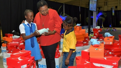 """These are for you for the INSPORTS Primary Schools Track and Field Championship for this year (2019)"", Minister Grange explains to these primary school children who will be participating in the three-day Meet which starts at the National Stadium on May 9. The Sport Minister was the keynote speaker at the launch function for the Meet at the National Indoor Sports Centre."