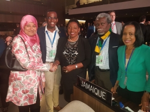 Well done, Minister! The Minister of Culture, Gender, Entertainment and Sport, the Honourable Olivia Grange (centre) is  congratulated by Madame Samira Almoosu Oman, Chairman of the Nominations Committee after Jamaica's successful election to the Executive Board of UNESCO. Also sharing the moment (L - R) are Mr O'Dayne Haughton, member of the Unesco Jamaica Youth Advisory Committee; Mr Everton Hannam, Secretary-General of the Jamaican National Commission for Unesco and Her Excellency Vilma McNish, Permanent Representative to the EU and Unesco.