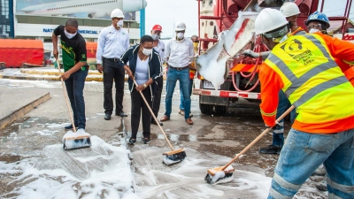 The Minister of Culture, Gender, Entertainment and Sport, the Honourable Olivia Grange (3rd left) and the Mayor of Kingston, Senator Councillor Delroy Williams (left), join the work crew from Carib Cement Company and Jamaica Pre-Mix in a Labour Day sanitisation project at Mandela Park in Half Way Tree.  Also pictured are: Sales Manager at Carib Cement Garen Williams; Managing Director of Jamaica Pre-Mix Limited, John Valentine; and Industrial and Builders Manager at Carib Cement, Andre Nelson.