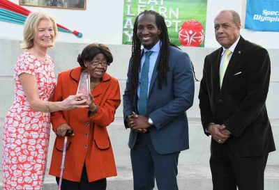 Minister of State in the Ministry of Culture, Gender, Entertainment and Sport, the Honourable Alando Terrelonge (second right) with Dr Lucille Buchannan, Founder, Special Olympics Jamaica (second left); Mary Davis, CEO, Special Olympics International and Ali McNab, Chairman, Special Olympics Jamaica. Dr. Buchannan was presented with an award in recognition of her role as a founding member of the Special Olympics movement in Jamaica, yesterday (April 10) at the Special Olympics Multipurpose Court at Independence Park.