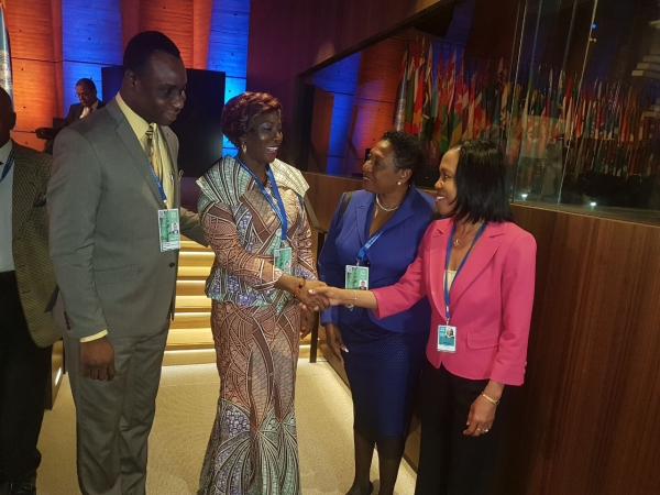 Mme Kandia Camara, Minister of Education of the Republic of Cote d'Ivoire greets Jamaica's Ambassador to the Kingdom of Belgium and Permanent Representative to the EU and UNESCO Her Excellency Vilma McNish, as the Hon Olivia Grange, Jamaica's Minister of Culture, Gender, Entertainment and Sport, and Mr Dean Roy Bernard, Permanet Secretary in Jamaica's Ministry of Education, Youth and Information look on.