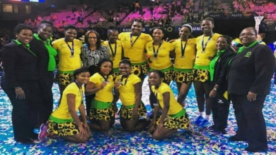 Members of Jamaica's senior netball team pose with their silver medal at the Fast5 Netball tournament in Australia.