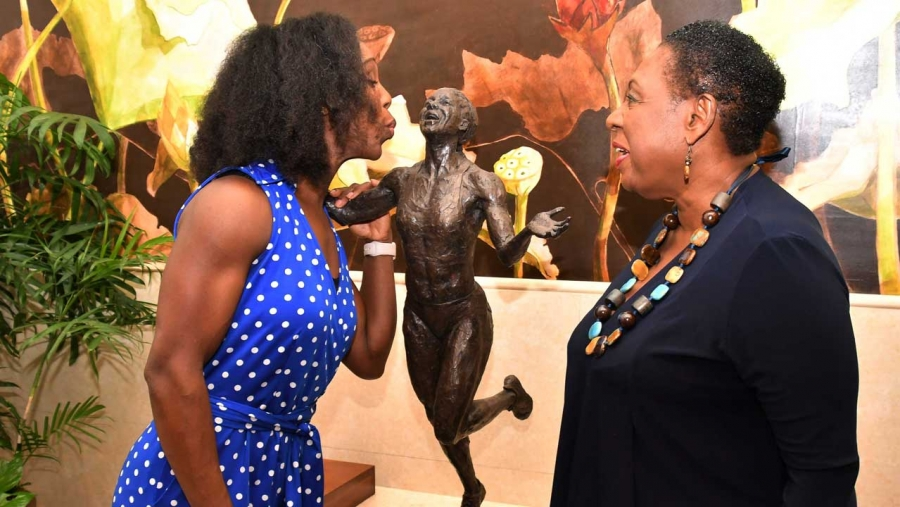 She loves it! Jamaican Olympian Veronica Campbell Brown reacts after being shown the design of the statue in her honour by the Minister of Culture, Gender, Entertainment and Sport, the Honourable Olivia Grange (right). The statue in tribute to Campbell Brown -- to the scale of one and quarter life size -- will be unveiled at Statue Park in the National Stadium complex on Sunday, 20 October 2019.