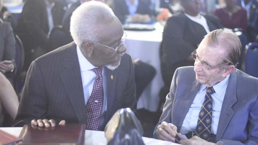 Former Prime Ministers of Jamaica share a moment together: The Most Honourable, Edward Seaga and P.J. Patterson