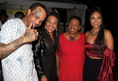 The Honourable Olivia Grange, the Minister of Culture, Gender, Entertainment and Sport shares a light moment with Recording Artistes Tommy Lee, Carlene Davis and Naomi Cowan (left-right) at last evening's Caribbean Love Concert. The concert was held to raise funds to assist Caribbean Countries that were devastated by the recent hurricanes.