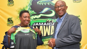 """Cricket lovely cricket"". A delighted Honourable Olivia Grange,  Minister of Culture, Gender, Entertainment and Sport, is presented with  a Jamaica Tallawahs shirt  by Mr Jefferson Miller, Chief Executive Officer,  Jamaica Tallwahs, at a news conference at the Jamaica Pegasus today (May 4).  Minister Grange announced a total of $12M dollars support from the  Government for the Tallawahs for the upcoming Caribbean Premier League Season."