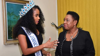 The Minister of Culture, Gender, Entertainment and Sport, the Honourable Olivia Grange, in discussion with Toni-Ann Singh