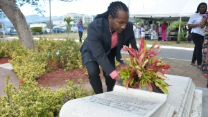 "Minister of State in the Ministry of Culture, Gender, Entertainment and Sport, the Honourable Alando Terrelonge makes a Floral Tribute at the resting place of Mallica ""Kapo"" Reynolds (National Heroes Park) on February 10, the anniversary of his 108th birthday."