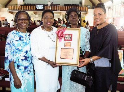 The Honourable Olivia Grange, Minister of Culture, Gender, Entertainment and Sport with Sylvia Henry, President of the Jamaica Baptist Women's Federation (second right); Dr Zoe Simpson (left), Executive Director, Women's Centre of Jamaica Foundation (WCJF) and Debby-Ann Brown Salmon, Board Chairman, WCJF (right). A plaque was presented to the Jamaica Baptist Women's Federation for their contribution to the Women's Centre programme for adolescent mother.