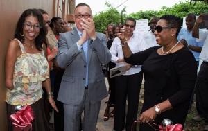 Three cheers for the newly renovated and expanded Woman Inc. Shelter in Kingston. The Honourable Olivia Grange, Minister of Culture, Gender, Entertainment and Sport shows delight as Eric Khant, Chargé d'Affaires, United States Embassy in Jamaica (c) applauds the completion of the work on the Shelter. Also sharing in the moment is Angela Stewart, Founder of Woman Inc. (l). The Shelter, which is operated by Woman Inc. was renovated through assistance from the United States Agency for International Development.